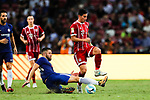 Chelsea Defender Gary Cahill (L) trips up with Bayern Munich Midfielder James Rodríguez (R) during the International Champions Cup match between Chelsea FC and FC Bayern Munich at National Stadium on July 25, 2017 in Singapore. Photo by Marcio Rodrigo Machado / Power Sport Images