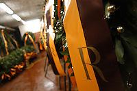 I dipendenti del Servizio Addobbi del Comune di Roma preparano le 500 corone commemorative per l'anniversario delle fosse Ardeatine, strage della dittatura nazifascista..Employees of service decorations of the Municipality of Rome prepare the 500 crowns for the commemorative anniversary of the Ardeatine ditches, the massacre of the Nazi dictatorship...