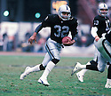 Los Angeles Raiders Marcus Allen (32) during a game from his career with the Raiders. Marcus Allen played for 16 years with 2 different teams, was a 6-time Pro Bowler and was inducted to the Pro Football Hall of Fame in 2003.