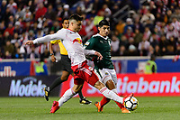 Harrison, NJ - Tuesday April 10, 2018: Florian Valot, Alan Pulido during leg two of a  CONCACAF Champions League semi-final match between the New York Red Bulls and C. D. Guadalajara at Red Bull Arena. C. D. Guadalajara defeated the New York Red Bulls 0-0 (1-0 on aggregate).