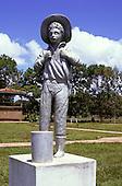 Belterra, Para State, Brazil. Statue of a boy rubber tapper.