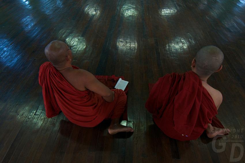 Meditating Monks In the Monastery near Yangon's large reclining Buddha that measures 70 meters long, Myanmar/Burma