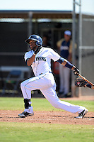 Seattle Mariners infielder Gianfranco Wawoe (10) during an Instructional League game against the Milwaukee Brewers on October 4, 2014 at Peoria Stadium Training Complex in Peoria, Arizona.  (Mike Janes/Four Seam Images)