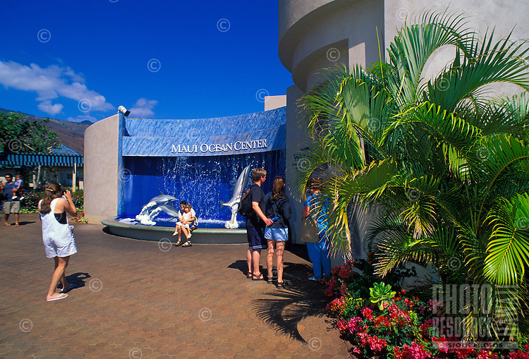 Tourists enjoy an afternoon and photo op at the Maui Ocean Center. Centrally located on Maui in Maalaea Harbor, the center is a popular tourist attraction.