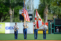Detroit Tigers have the local color guard present the colors before a Spring Training game against the Atlanta Braves at Joker Marchant Stadium on February 27, 2013 in Lakeland, Florida.  Atlanta defeated Detroit 5-3.  (Mike Janes/Four Seam Images)