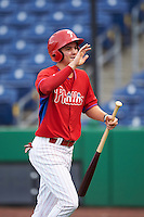 GCL Phillies center fielder Mickey Moniak (15) high fives teammates after scoring a run during a game against the GCL Blue Jays on August 16, 2016 at Bright House Field in Clearwater, Florida.  GCL Blue Jays defeated GCL Phillies 2-1.  (Mike Janes/Four Seam Images)