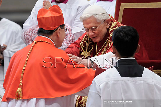 Philippines' Cardinal Luis Antonio Tagle,Pope Benedict XVI leads a ceremony to appoint six new cardinals at St Peter's basilica at the Vatican.November 24, 2012