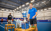 Amstelveen, Netherlands, 20  December, 2020, National Tennis Center, NTC, NK Indoor, National  Indoor Tennis Championships, Men's  Single Winner   :  Jelle Sels (NED)<br /> picks up his trophy, left runner up Botic vd Zandschulp (NED)<br /> Photo: Henk Koster/tennisimages.com