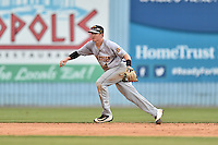 Charleston RiverDogs shortstop Kyle Holder (4) reacts to the ball during game one of a double header against the Asheville Tourists at McCormick Field on July 8, 2016 in Asheville, North Carolina. The RiverDogs defeated the Tourists 10-4 in game one. (Tony Farlow/Four Seam Images)