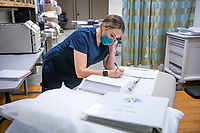 Brittney Horn reviews intructions for a procedure as UAA Medical Assisting Program students learn to sterilize medical instruments during their first in-person lab of the Fall 2020 semester. While 80% of UAA's courses have shifted to online delivery this fall as a result of the COVID-19 pandemic, in-person labs are still being offered for some health-related, vocational, and science fields in which hands-on learning is considered critical.