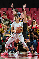 COLLEGE PARK, MD - FEBRUARY 13: Monika Czinano #25 blocks Shakira Austin #1 of Maryland during a game between Iowa and Maryland at Xfinity Center on February 13, 2020 in College Park, Maryland.
