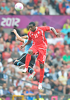 July 26, 2012..UAE's Ahmed Khalil (11) leaps for a header. UAE vs Uruguay Football match during 2012 Olympic Games at Old Trafford in Manchester, England. Uruguay defeat United Arab Emirates 2-1...
