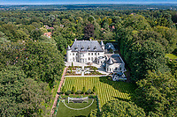 BNPS.co.uk (01202 558833)<br /> Pic: Savills/BNPS<br /> <br /> Pictured: An aerial view of the chateau.<br /> <br /> A striking turreted French style chateau in one of the UK's most desirable streets is on the market for £9.25m.<br /> <br /> Deauville is an impressive mansion with a striking period exterior but a stylish contemporary look inside and all the mod cons a home owner would want, including an indoor pool complex and cinema room.<br /> <br /> The house is in the prestigious St George's Hill estate in Weybridge, Surrey, which is renowned all over the world.<br /> <br /> The five-bedroom house was built in 2000 but has undergone an extensive refurbishment in the last few years.
