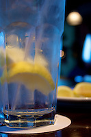 Chilled glass of water with lemon pieces inside giving it a hint of sourness and zest for life.