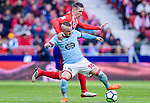 Stanislav Lobotka of RC Celta de Vigo (front) fights for the ball with Fernando Torres of Atletico de Madrid (back) during the La Liga 2017-18 match between Atletico de Madrid and RC Celta de Vigo at Wanda Metropolitano on March 11 2018 in Madrid, Spain. Photo by Diego Souto / Power Sport Images