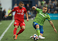 SEATTLE, WA - NOVEMBER 10: Toronto FC defender Auro #96 and Seattle Sounders forward Jordan Morris #13 battle for the ball during a game between Toronto FC and Seattle Sounders FC at CenturyLink Field on November 10, 2019 in Seattle, Washington.
