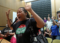 City council candidate Nikuyah Walker screams into the microphone at councilors during the Charlottesville City Council meeting Monday night in Charlottesville, Va. Photo/Andrew Shurtleff