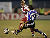 14 May 2005:  Bobby Rhine of FC Dallas kicks the ball away from Dwayne De Rosario of Earthquakes during the second half of the game at Spartan Stadium in San Jose, California.  Earthquakes tied FC Dallas, 0-0.   Credit: Michael Pimentel / ISI