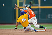 Miami Hurricanes second baseman Johnny Ruiz (4) waits for a throw to second as UC Santa Barbara Gauchos baserunner Billy Fredrick (26) arrives during Game 5 of the NCAA College World Series on June 20, 2016 at TD Ameritrade Park in Omaha, Nebraska. UC Santa Barbara defeated Miami  5-3. (Andrew Woolley/Four Seam Images)