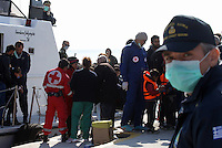 Pictured: A Coastguard officer looks on as the vessel carrying some of the illegal immigrants docks to Ierapetra Thursday 27 November 2014<br />