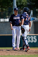Pitcher Karson Ligon (3) talks with catcher Rene Lastres (23) during the Baseball Factory All-Star Classic at Dr. Pepper Ballpark on October 4, 2020 in Frisco, Texas.  Pitcher Karson Ligon (3), a resident of Sarasota, Florida, attends Riverview High School.  (Mike Augustin/Four Seam Images)