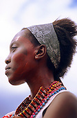 Lolgorian, Kenya. Maasai woman with red ochre face paint at the Eunoto coming of age ceremony.