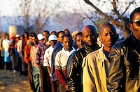 Voters at the front of the queue on the day of the country's first democratic multiracial election