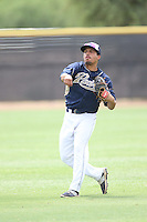 Tyler Moore (14) of the AZL Padres throws before a game against the AZL Rangers at the San Diego Padres Spring Training Complex on July 4, 2015 in Peoria, Arizona. Padres defeated the Rangers, 9-2. (Larry Goren/Four Seam Images)