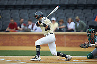 Patrick Frick (5) of the Wake Forest Demon Deacons follows through on his swing against the Miami Hurricanes at David F. Couch Ballpark on May 11, 2019 in  Winston-Salem, North Carolina. The Hurricanes defeated the Demon Deacons 8-4. (Brian Westerholt/Four Seam Images)