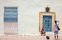 Tunisia, Sidi Bou Said.  Blue and white are the traditional colors of the houses of Sidi Bou Said.  The village is a popular tourist destination just outside Tunis.