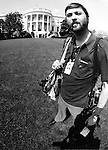 Ron Bennett White House News Photographer with south lawn in background,
