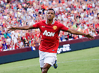 Nani (17) of Manchester United celebrates his goal during the friendly at FedEX Field in Landover, MD.  Manchester United defeated FC Barcelona, 2-1.