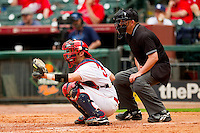 Catcher John Cannon #37 of the Houston Cougars sets a target as home plate umpire Ken Langford looks on during the game against the Baylor Bears at Minute Maid Park on March 4, 2011 in Houston, Texas.  Photo by Brian Westerholt / Four Seam Images