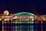 Seattle Skyline, Elliott Bay , Apogee moon, super moon, stadium district and Alaskan Way Viaduct at dusk.
