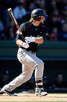 First baseman Kyle Martin (33) of the South Carolina Gamecocks drives in a run in the big fifth inning of the Reedy River Rivalry game against the Clemson Tigers on March 1, 2014, at Fluor Field at the West End in Greenville, South Carolina. South Carolina won, 10-2.  (Tom Priddy/Four Seam Images)