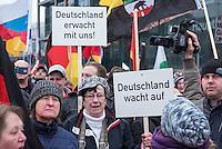 """Etwa 2.000 rechtsradikale Menschen demonstrierten am Samstag den 12. Maerz 2016 in Berlin unter dem Motto """"Merkel muss weg!"""" gegen Angela Merkel, gegen Fluechtlinge und fuer """"Das deutsche Vaterland"""".<br /> Bis auf wenige Ausnahmen waren angereisten Teilnehmer Neonazis und Hooligans, NPD-, Pediga- und AfD-Mitglieder.<br /> Aufgerufen zu dem Aufmarsch hatten die Hooligan-Gruppen """"Buendnis fuer Deutschland"""" und """"Buendnis fuer Berlin"""".<br /> Im Bild: Es werden Schilder mit der Aufschrift """"Deutschland erwacht mit uns!"""" und Deutschland wacht auf"""" hochgehalten.<br /> 12.3.2016, Berlin<br /> Copyright: Christian-Ditsch.de<br /> [Inhaltsveraendernde Manipulation des Fotos nur nach ausdruecklicher Genehmigung des Fotografen. Vereinbarungen ueber Abtretung von Persoenlichkeitsrechten/Model Release der abgebildeten Person/Personen liegen nicht vor. NO MODEL RELEASE! Nur fuer Redaktionelle Zwecke. Don't publish without copyright Christian-Ditsch.de, Veroeffentlichung nur mit Fotografennennung, sowie gegen Honorar, MwSt. und Beleg. Konto: I N G - D i B a, IBAN DE58500105175400192269, BIC INGDDEFFXXX, Kontakt: post@christian-ditsch.de<br /> Bei der Bearbeitung der Dateiinformationen darf die Urheberkennzeichnung in den EXIF- und  IPTC-Daten nicht entfernt werden, diese sind in digitalen Medien nach §95c UrhG rechtlich geschuetzt. Der Urhebervermerk wird gemaess §13 UrhG verlangt.]"""
