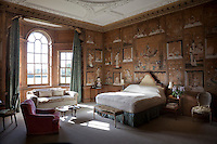 A chinoiserie bedroom with hand-painted Chinese wallpaper