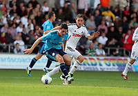 Pictured: Joe Allen of Swansea (R). Saturday 17 September 2011<br /> Re: Premiership football Swansea City FC v West Bromwich Albion at the Liberty Stadium, south Wales.