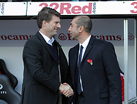 Saturday, 03 November 2012<br /> Pictured L-R: Swansea manager Michael Laudrup greets Chelsea manager Roberto di Matteo.<br /> Re: Barclays Premier League, Swansea City FC v Chelsea at the Liberty Stadium, south Wales.