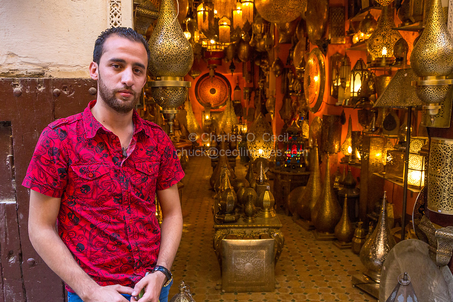 Fes, Morocco.  Vendor at Shop Selling Brass Lanterns and other Metal Utensils.