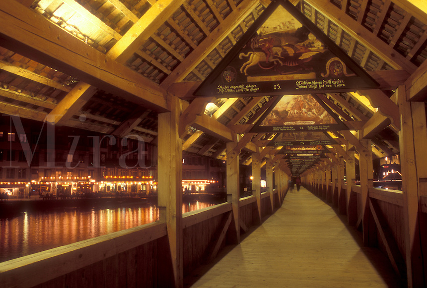 AJ1689, Lucerne, Switzerland, covered bridge, Luzern, Europe, There are more than 100 gable paintings on the interior of the 14th century covered pedestrian bridge, the Kapellbrucke, on the Reuss in the evening in Lucerne in the Canton of Lucerne.