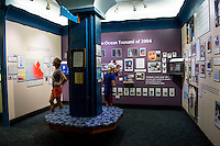 Visitors look over the many exhibits at the Pacific Tsunami Museum in downtown Hilo, Big Island of Hawai'i.
