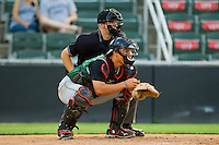 Augusta GreenJackets catcher Eric Sim #16 sets a target as home plate umpire Charlie Tierney looks on during the game against the Kannapolis Intimidators at CMC-Northeast Stadium on May 2, 2012 in Kannapolis, North Carolina.  The GreenJackets defeated the Intimidators 9-6.  (Brian Westerholt/Four Seam Images)