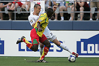 Heath Pearce (2) tries to control the ball against Cassim Langainge (front). USA defeated Grenada 4-0 during the First Round of the 2009 CONCACAF Gold Cup at Qwest Field in Seattle, Washington on July 4, 2009.