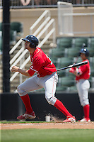 Brendon Hayden (34) of the Lakewood BlueClaws follows through on his swing against the Kannapolis Intimidators at Kannapolis Intimidators Stadium on May 8, 2016 in Kannapolis, North Carolina.  The Intimidators defeated the BlueClaws 3-2.  (Brian Westerholt/Four Seam Images)