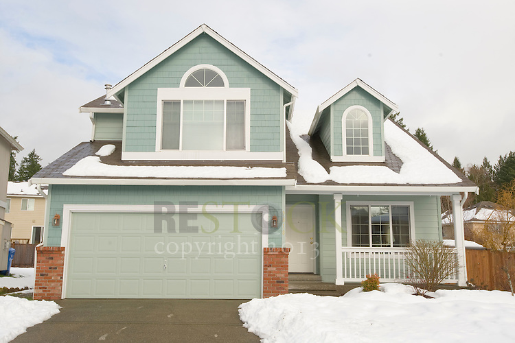 Teal House in Snow
