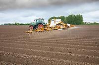 Spraying residual herbicide following rain onto potato ridges - Licolnshire, April
