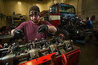 Diesel Power Technology student Greg Perez works on a diesel engine during class in UAA's Auto Diesel Technology Building.