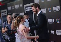 Liam Hemsworth + Joey King @ the premiere of 'Independence Day: Resurgence' held @ the Chinese theatre.<br /> June 20, 2016.