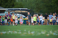 Young Batavia Muckdogs fans rush the field for the post game helicopter candy drop after a game against the Hudson Valley Renegades on July 31, 2016 at Dwyer Stadium in Batavia, New York.  Hudson Valley defeated Batavia 4-1. (Mike Janes/Four Seam Images)